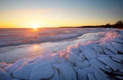 Winter landscape with frozen lake and sunset sky. Royalty Free Stock Photos