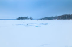 Winter landscape with frozen lake. And trees in the background Royalty Free Stock Photography