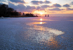 Winter landscape with frozen reservoir and power plant Stock Images