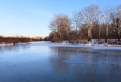 Winter landscape with frozen river Stock Image