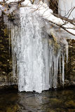 Winter landscape with frozen waterfall Stock Photos