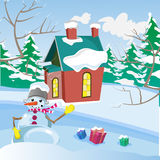 Winter landscape. Funny snowman with gifts. Winter landscape. The house with a chimney. The smoke from the chimney. Freezing day. New Year`s and Christmas Royalty Free Stock Photo