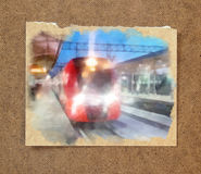Winter landscape in gloomy day. A bright red train arrives on a. Snow-covered platform. in the passepartout Stock Images