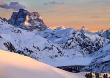 Winter landscape of high snowy mountains. Sunset, sunrise in Alpes - european skiing resort Royalty Free Stock Photos
