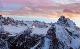 Winter landscape of high snowy mountains. Sunset, sunrise in Alpes - european skiing resort Royalty Free Stock Photography