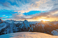 Winter landscape of high snowy mountains. Sunset, sunrise in Alpes - european skiing resort Royalty Free Stock Image