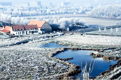 Winter landscape high view over a farmhouse Royalty Free Stock Image