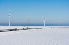 Winter landscape with highway and windturbines Royalty Free Stock Images