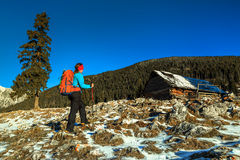 Winter landscape with hiker woman,Carpathians,Transylvania,Romania,Europe Stock Photography