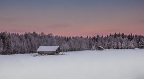 Beautiful Winter Landscape in Lapland,Finland. Winter landscape, house in the forest.Lapland,Finland Stock Photos