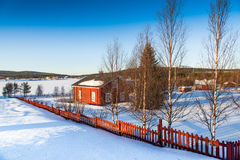 Winter landscape with house at lake in Scandinavia Royalty Free Stock Photo