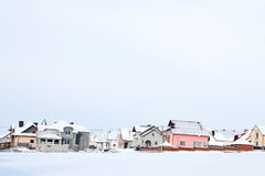 Winter landscape with houses Stock Photos