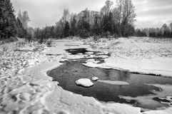 Winter landscape. Ice-river. Water flows in the winter. Winter landscape. Ice-river. Cloudy day. Siberia. Black-and-white image royalty free stock photo