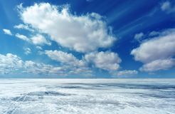 Winter landscape with ice, snow, and clouds. royalty free stock image