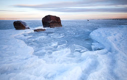Ice and stones on frozen Baltic Sea Royalty Free Stock Images