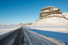 Winter landscape, icelandic main road and beautiful Lomagnupur mountain Royalty Free Stock Photography