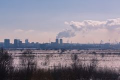 Winter landscape industrial outskirts of the city. Silhouettes of buildings and cranes. Winter landscape industrial outskirts of the city. Silhouettes of royalty free stock photo