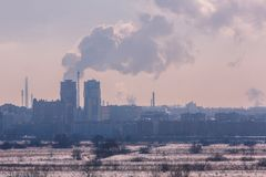 Winter landscape industrial outskirts of the city. Silhouettes of buildings and cranes. Winter landscape industrial outskirts of the city. Silhouettes of stock image