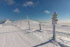 Winter landscape of Krkonose Mountains with Snezka Hill. Beautiful winter landscape Krkonos on a sunny day. Stock Photos