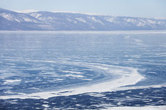 Winter landscape. Lake Baikal ice. Mountain shore. Lake Baikal ice. Mountain shore. Winter landscape Royalty Free Stock Image