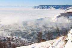 Winter landscape of Lake Baikal. Start of the Angara river Stock Photos