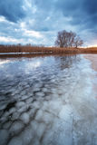 Winter landscape with lake and cloudy sky. Royalty Free Stock Image