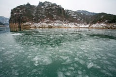 Winter landscape with lake covered with ice frozen Stock Photo