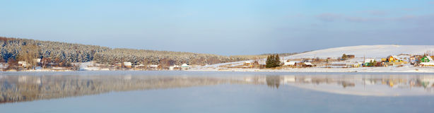 Winter landscape on lake in a sunny day Stock Image