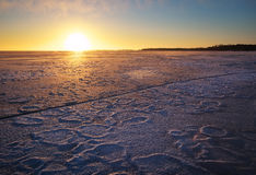 Winter landscape with lake and sunset fiery sky. Royalty Free Stock Photography