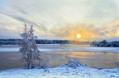 Winter landscape with lake and trees covered with frost Stock Photo
