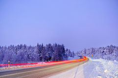 Winter landscape in Lapland Finland. The road, snow-covered trees, polar night royalty free stock photography