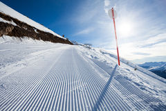 Winter landscape of long ski-track with sign Royalty Free Stock Photos