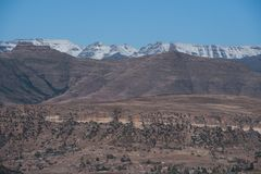 Winter landscape Maluti Mountains Lesotho Africa. View point over Winter landscape with snow capped Maluti Mountains Lesotho Africa Royalty Free Stock Images