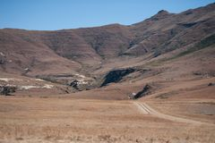Winter landscape Maluti Mountains Lesotho Africa. With dirt track leading into the distance Stock Photo