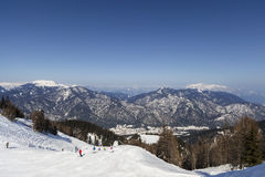 Winter landscape. Many people skiing in front of a wonderful landscape royalty free stock photography