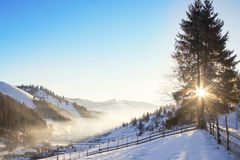Winter landscape morning over countryside village with sunrays a Royalty Free Stock Photography