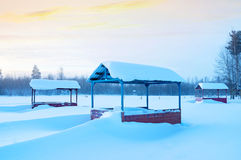 Winter landscape. Winter morning landscape with snow-covered arbors for rest Royalty Free Stock Photos