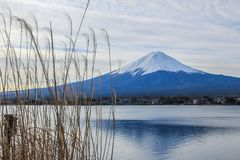 Winter landscape with Mount Fuji, village and lake. Nature of Japan. Famous and beautiful places in the world. Fuji reflection in the lake. Travel around Japan stock photo