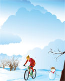 Winter landscape with a mountain biker. Stock Photography