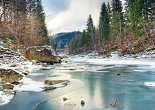 Winter landscape with mountain river Stock Photo