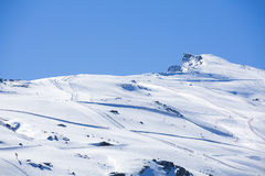Winter landscape on mountain with ski lift and ski slope. Royalty Free Stock Photography