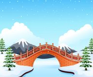 Winter landscape with mountain and small stone bridge over river Royalty Free Stock Image