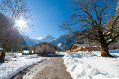 Winter landscape in a mountain valley with huts. Stock Photo