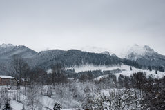 Winter landscape. Mountain village in the Bran,Romanian Carpathians Stock Photography