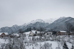 Winter landscape. Mountain village in the Bran,Romanian Carpathians Royalty Free Stock Photo