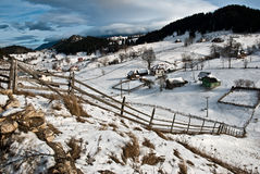 Winter landscape. Mountain village in the Romania Royalty Free Stock Photography