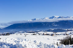 Winter landscape with a mountain village Stock Images
