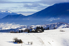 Winter landscape with a mountain village Stock Photos