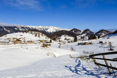 Winter landscape with a mountain village Royalty Free Stock Images