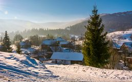 Winter landscape in mountainous rural area. Village in mountainous area in winter carpathian landscape. location Pylypets, Ukraine Stock Image